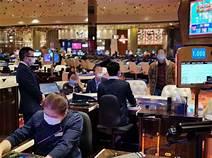 Masks, no smoking and crowd cutbacks as US casinos reopen