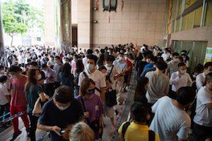 Macau arrivals fall as Covid cases rise
